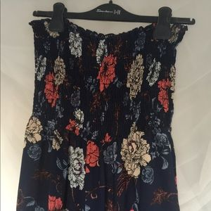 Blue Stretchy jumpsuit with flower designs
